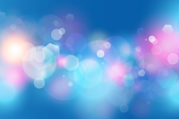 Bokeh background with sparkles of dust in cold colours Premium Vector