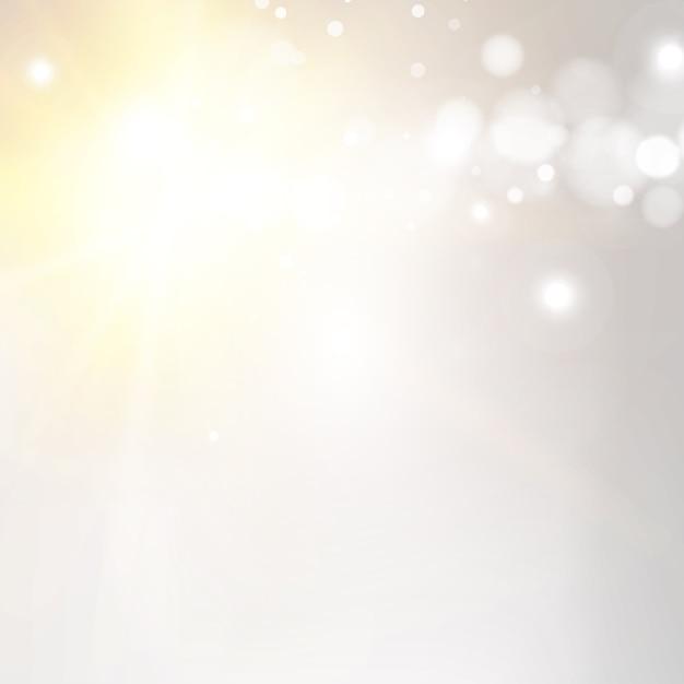 Sfondo bokeh con raggi di sole Vettore gratuito