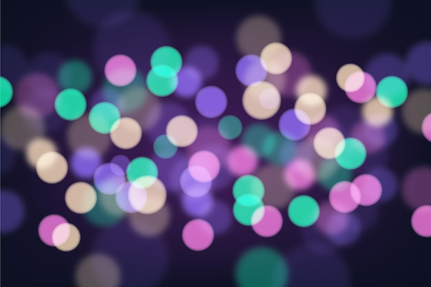 Bokeh blurred particles background Free Vector