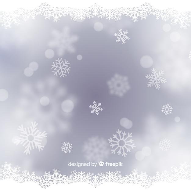 Bokeh christmas background Free Vector