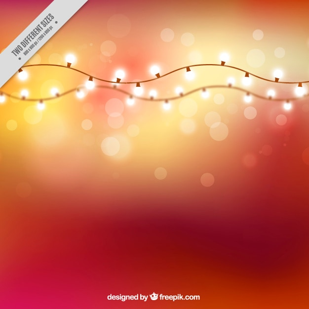 Bokeh effect background with garlands of lights Free Vector