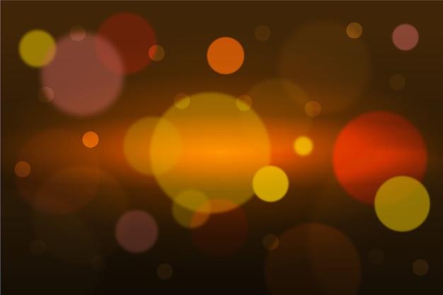 Боке золотой световой эффект на темном фоне Бесплатные векторы