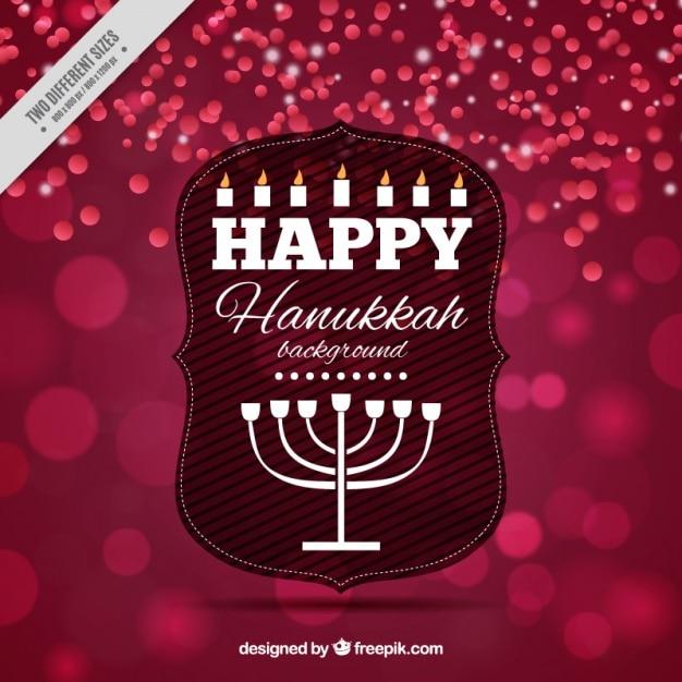 Bokeh hanukkah background with candelabra Free Vector