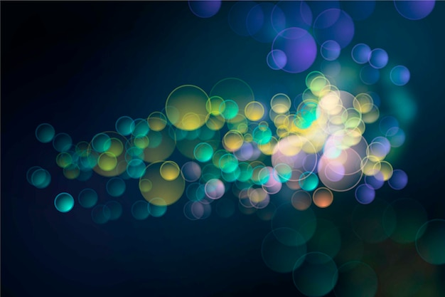 Bokeh lights effect on dark background Free Vector
