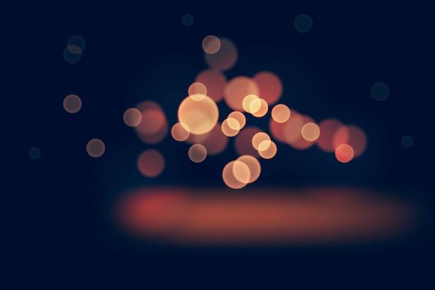 Bokeh lights effect on dark background Free Vector