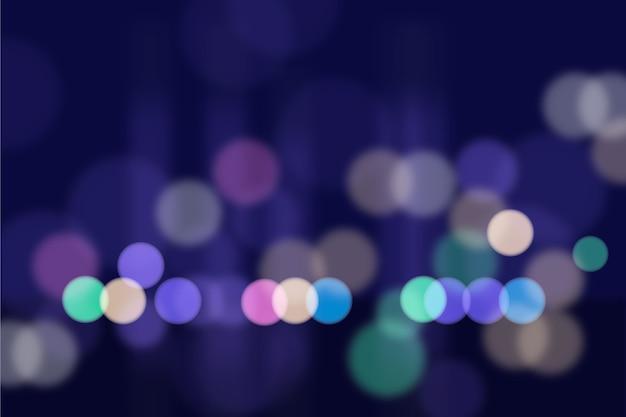 Bokeh shiny lights background Free Vector