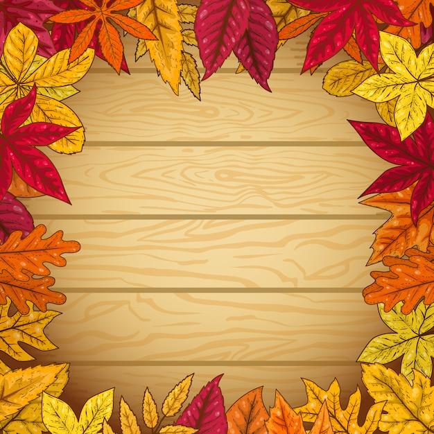 木製の背景に紅葉からの境界線。ポスター、カードの要素。図 Premiumベクター