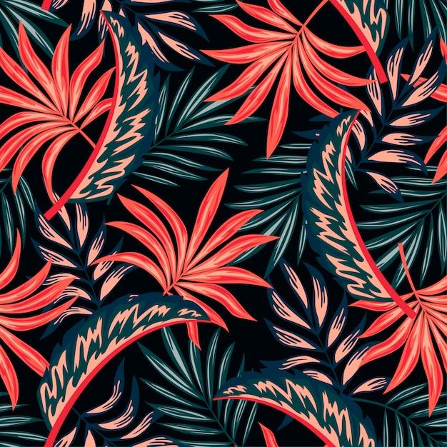 Ботанический бесшовные тропический узор с яркими растениями и листьями на темном фоне Premium векторы