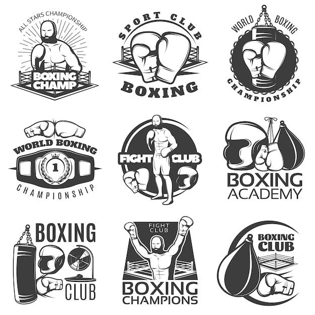 Emblemi bianchi neri di pugilato dei club e dei campionati con il premio dell'attrezzatura sportiva del combattente isolato Vettore gratuito