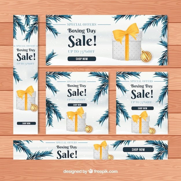 Boxing day sale banner with fir leaves Free Vector