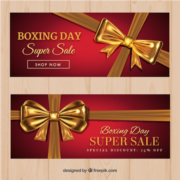 Boxing day sale banners with gold ribbon Free Vector