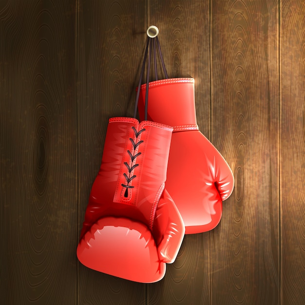Boxing gloves on wall Free Vector