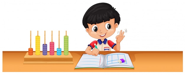 Boy calculating math on the desk Free Vector