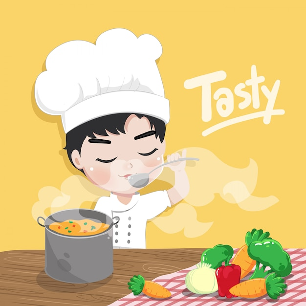 The boy chef is tasting food in the kitchen room Premium Vector