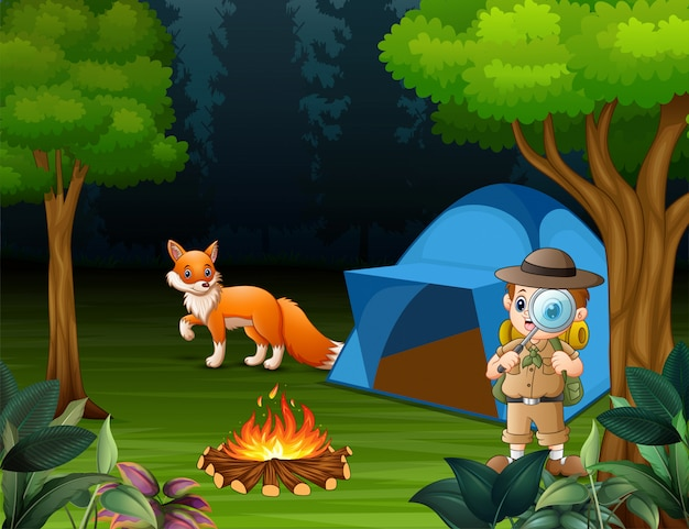 Boy explorer camping in the forest and a fox near the tent Premium Vector
