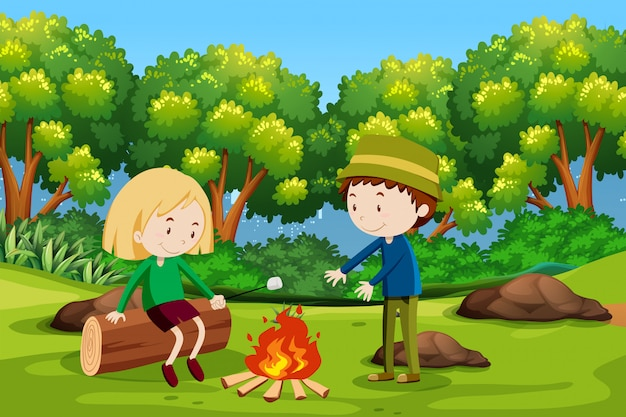 Boy and girl camping at forest Premium Vector