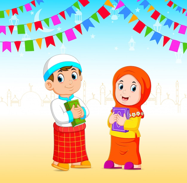 The boy and the girl is holding the al quran in the ramadan event Premium Vector