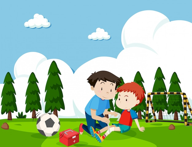 Boy injured from football Free Vector