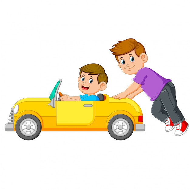 The boy is pushing the yellow car with his friend on it Premium Vector