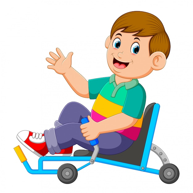 The boy is sitting on the recumbent tricycle and holding the controller Premium Vector