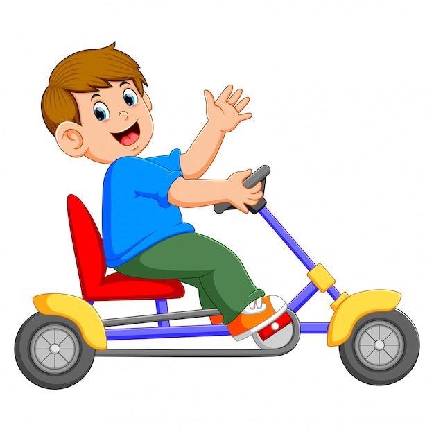 The boy is sitting and riding on the tricycle Premium Vector
