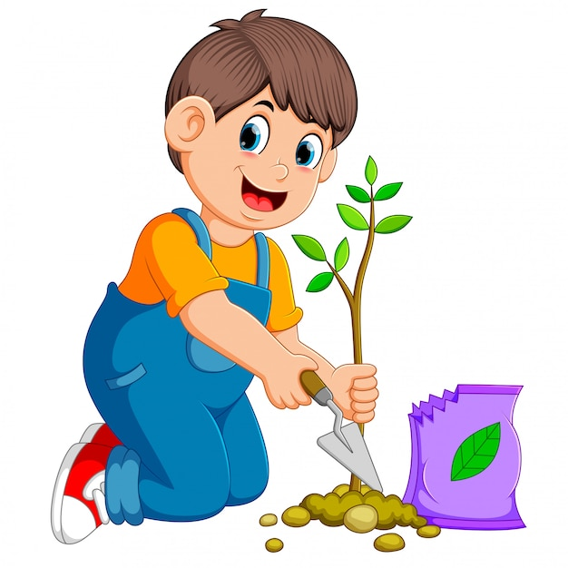 A boy planting a green young plant with fertilizer Premium Vector