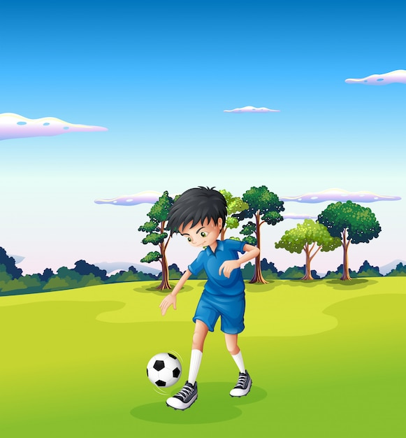 A boy playing soccer at the forest Free Vector