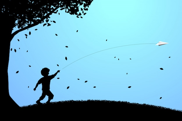 Boy running to throw out origami paper airplane Premium Vector