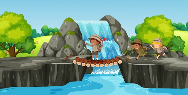 Boy scout hiking in nature Premium Vector