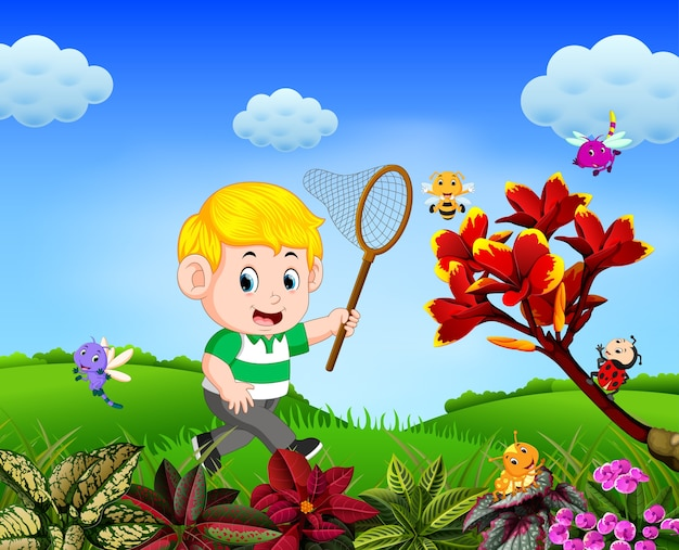 Boy tries to catch a butterfly in the garden Premium Vector