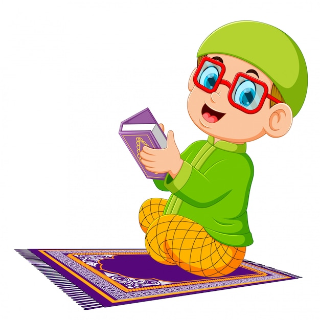 The boy using the red glasses is holding al quran Premium Vector