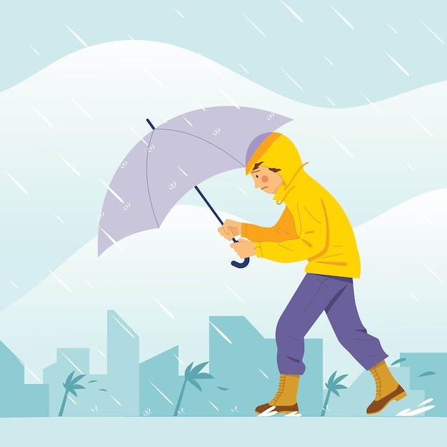 傘で大きな嵐を歩く少年 Premiumベクター