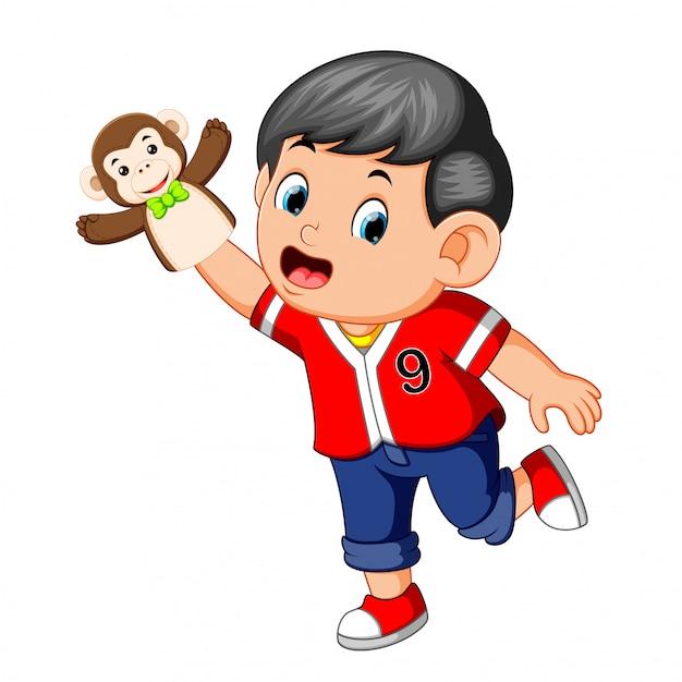 The boy was using monkey puppet Premium Vector
