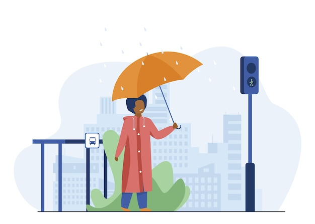 Boy with umbrella crossing road in rainy day. city, pedestrian, traffic lights flat vector illustration. weather and urban lifestyle Free Vector