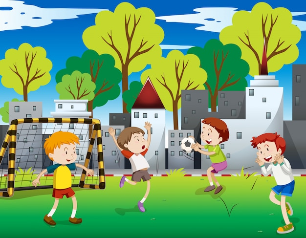 Boys playing football in the field Free Vector
