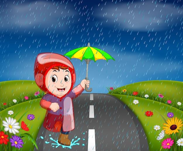 Boys in raincoat running on road Premium Vector