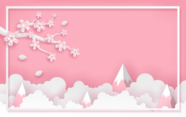 Branch and sakura flower frame template with clouds and mountain in vector paper art concept. Premium Vector