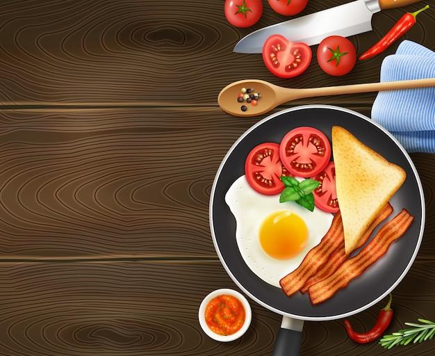 Breakfast in frying pan top view Free Vector