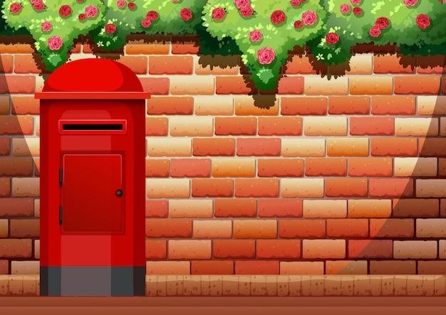 Brick wall and post box Free Vector