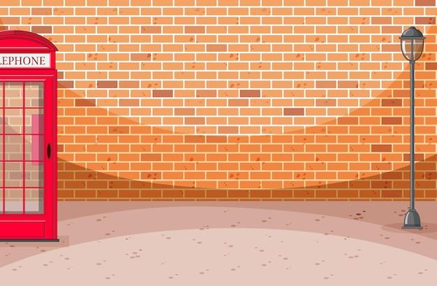 Scena di strada del muro di mattoni con scatola del telefono Vettore gratuito