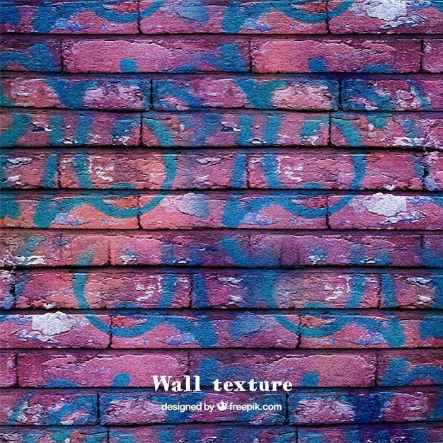 Brick wall texture with graffiti Free Vector
