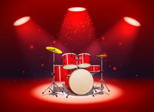 Bright red drum set in the light of spotlights Premium Vector
