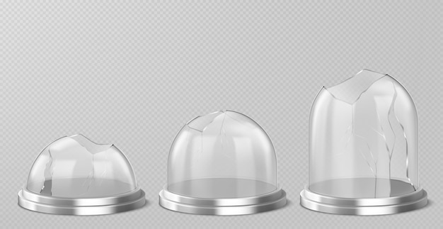 Broken glass domes on silver podium. realistic template of empty clear acrylic bell jars with cracks and holes. damaged snow balls on metal stand isolated on transparent background Free Vector