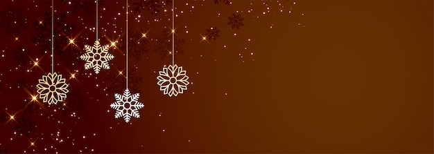 Brown christmas snowflakes banner with copyspace Free Vector