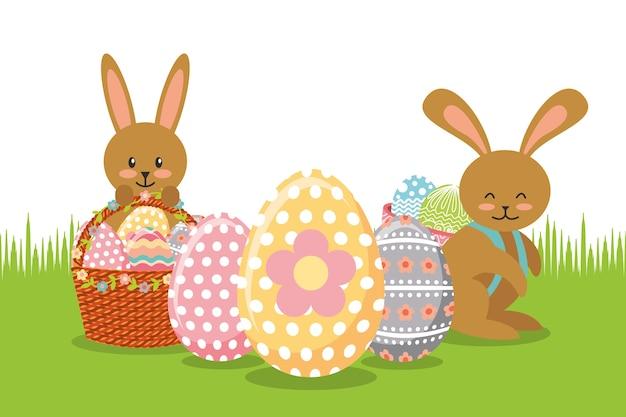 Браун-кролики с корзинами и украшением яиц на лугу Premium векторы