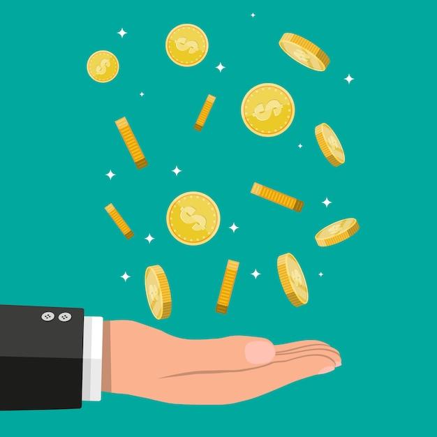 Buisnessman hand catching falling gold coins. Premium Vector