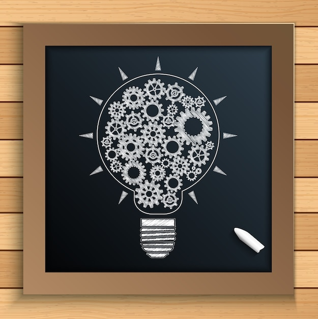 Bulb idea with gears written by chalk on blackboard Premium Vector