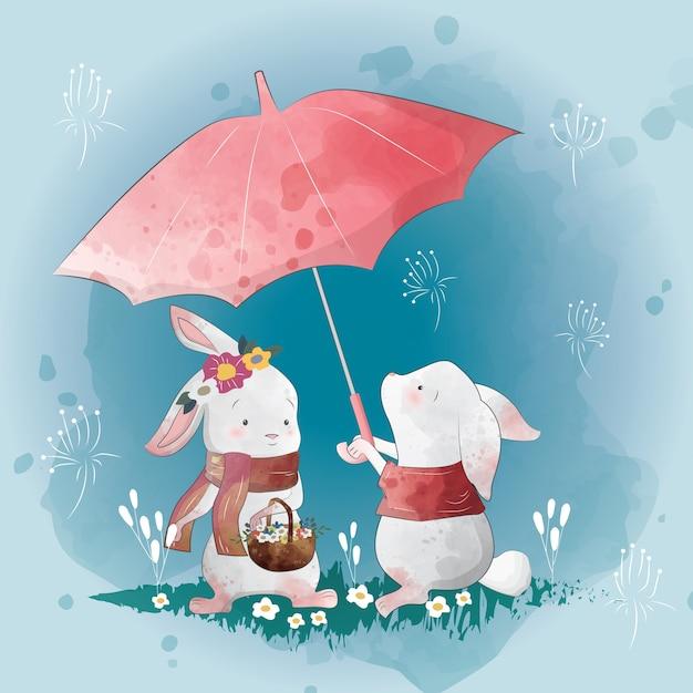 Bunny love in the rain Premium Vector