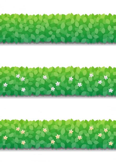 茂みの生垣と分離された小さな花。緑の茂みフェンスシームレスパターン。 Premiumベクター