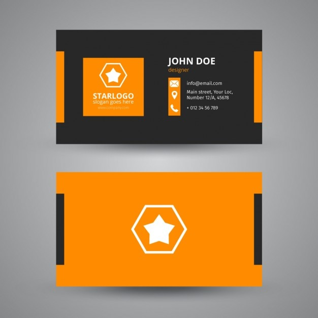 Business card in black and orange free vector